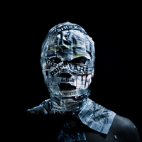Portrait of anonymous man wrapped in newspapers on black background 20071011734| 写真素材・ストックフォト・画像・イラスト素材|アマナイメージズ