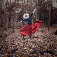 Woman wearing red skirt dancing in the woods. Brussels, Belgium 20071011772| 写真素材・ストックフォト・画像・イラスト素材|アマナイメージズ