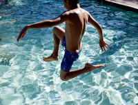 Boy leaps into pool