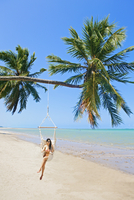 South America, Brazil, Alagoas, Praia do Patacho, an attractive young woman sitting in a hammock chair on the beach MR 20088003035| 写真素材・ストックフォト・画像・イラスト素材|アマナイメージズ