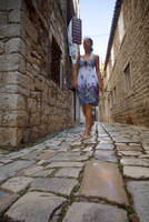 Croatia, Trogir, Central Europe. Young woman walking in the historical centre. MR 20088020862| 写真素材・ストックフォト・画像・イラスト素材|アマナイメージズ