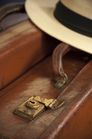 Vintage Leather Suitcase with Panama Hat