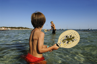 Children playing beach tennis, Cala de Ses Salines, Ibiza, Ibiza and Formentera, Balearic Islands, Spain