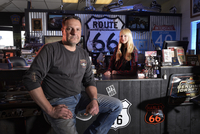 Owner Peter Fischer with Angelina, Eagle Rider Harley store and shop on route 66, Arizona, USA 20088089120| 写真素材・ストックフォト・画像・イラスト素材|アマナイメージズ