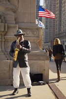 USA, Illinois, Chicago. MUsician performing on Michigan Avenue.
