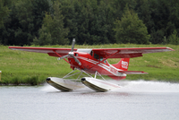 Alaska, USA, Anchorage. A floatplane operated by Rust's Flying Service takes off from Lake Hood. 20088091997| 写真素材・ストックフォト・画像・イラスト素材|アマナイメージズ