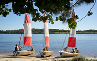 Children waiting for a sailing lesson on the Maroochy River in Queensland.