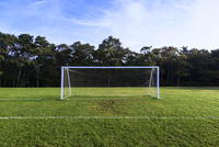 The goal and net on a football pitch.
