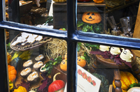 Halloween sweets and treats on display in a shop window.