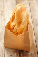 Two baguettes in a paper bag 22199069172| 写真素材・ストックフォト・画像・イラスト素材|アマナイメージズ