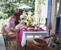Family meeting together on the garden terrace 22199074156| 写真素材・ストックフォト・画像・イラスト素材|アマナイメージズ