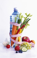 A bottle of water with a measuring tape, vegetables and frui 22199075778| 写真素材・ストックフォト・画像・イラスト素材|アマナイメージズ
