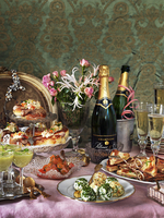 A New Year's Eve buffet with champagne, cheese balls, avocado soup, salmon, hot dogs, toast and flowers 22199090766| 写真素材・ストックフォト・画像・イラスト素材|アマナイメージズ