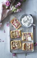 Rhubarb and puff pastry slices with cream (seen from above) 22199091120| 写真素材・ストックフォト・画像・イラスト素材|アマナイメージズ