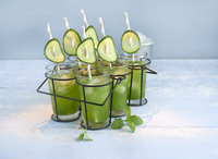 Cucumber and lime smoothies with mint in glasses in a cup holder 22199091680| 写真素材・ストックフォト・画像・イラスト素材|アマナイメージズ