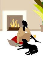 暖炉の前でくつろぐ女性と犬 22987000070  写真素材・ストックフォト・画像・イラスト素材 アマナイメージズ