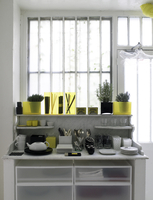 Kitchen with homeware and plants on storage unit next to window in French residential home. 25937008022| 写真素材・ストックフォト・画像・イラスト素材|アマナイメージズ
