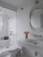 White mosaic tiled bathroom with toilet and basin and vintage mirror in residential house, USA. 25937008480| 写真素材・ストックフォト・画像・イラスト素材|アマナイメージズ