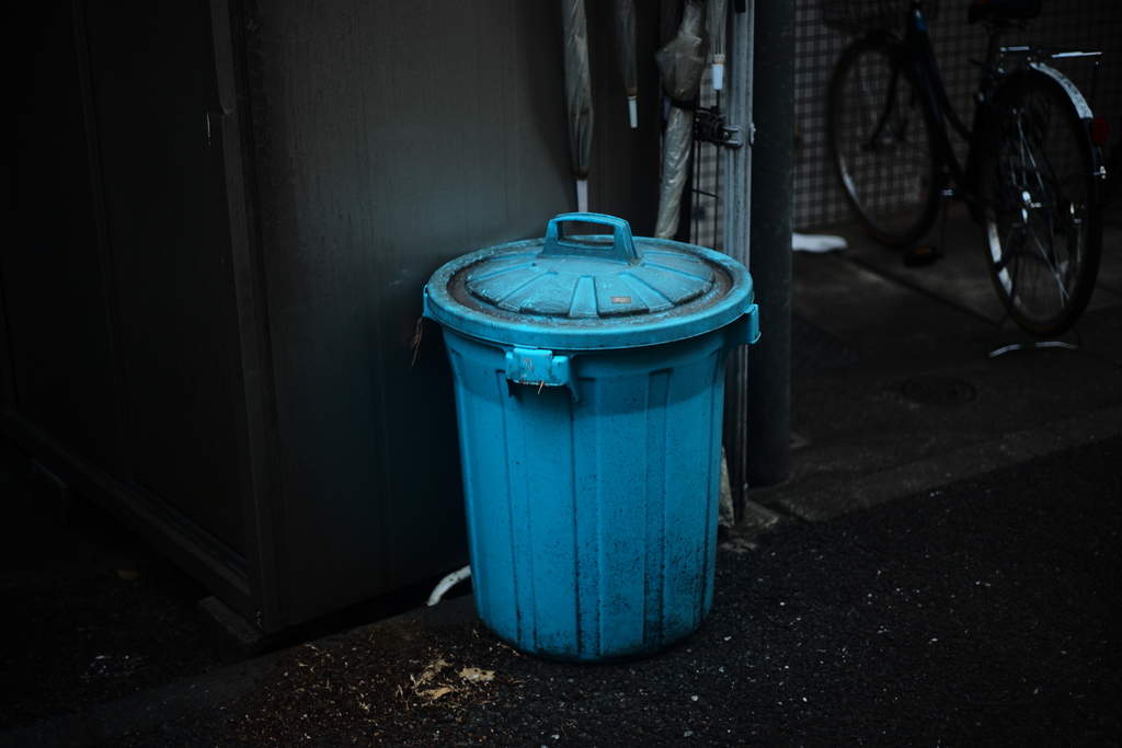 Blue trash can.