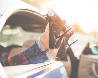 Medium sexy woman legs on high heels out of car windows picjumbo com