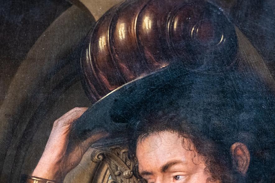 シワやイボ、無精髭まで細かく描き込まれた肖像画。
