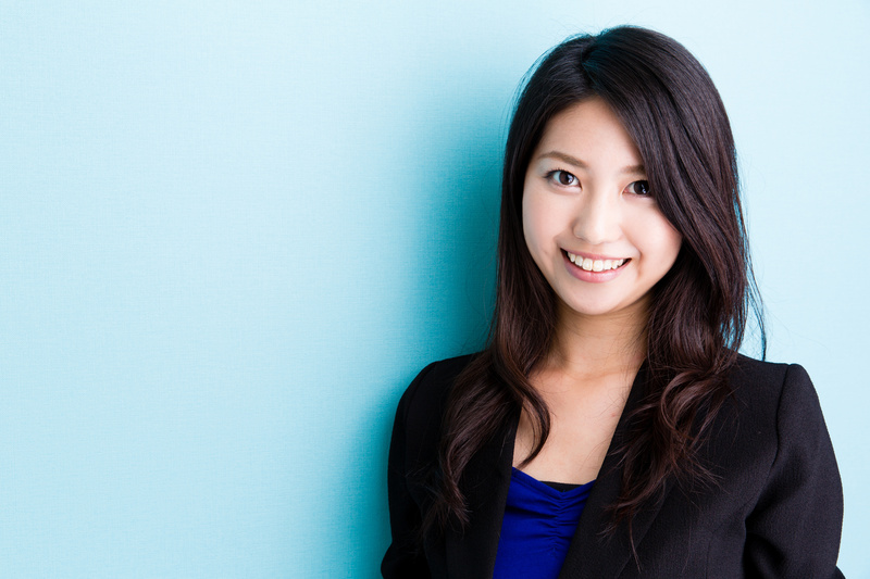 asian businesswoman on blue background