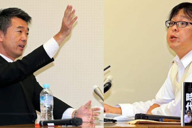 激しく言い合う橋下市長(左)と在特会の桜井会長=20日、大阪市役所