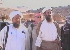 カタールの衛星テレビ・アルジャジーラで放映されたビンラディン氏の近影(右)=2001年10月5日、同テレビのホームページより