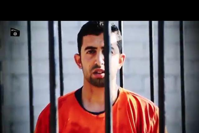 ヨルダン空軍のムアーズ・カサースベ中尉と見られる男性。檻の中で焼き殺された映像が公開された