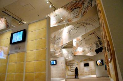 「ガンダム展」の安彦良和さんの原画を展示する部屋には、目の部分を拡大した垂れ幕がかかっていた=2014年7月、大阪市港区の大阪文化館・天保山