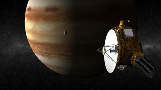 加速のため、木星に近づくニューホライズンズの想像図=NASA提供