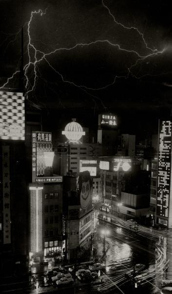 銀座のネオンサインの上空に光る稲妻=1966年2月
