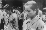 終戦の「玉音放送」を聞き、涙を流す海軍軍需工場に動員された女学生=1945年8月15日