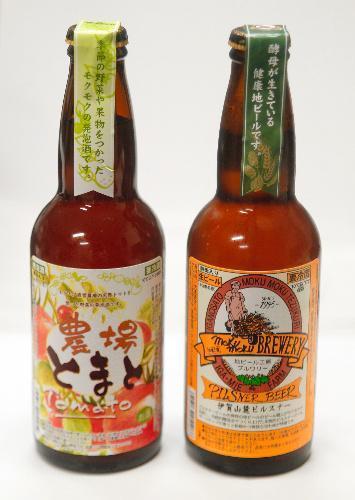 (三重)発泡酒「農場とまと」(左)と、復刻地ビール「伊賀山麓ピルスナー」