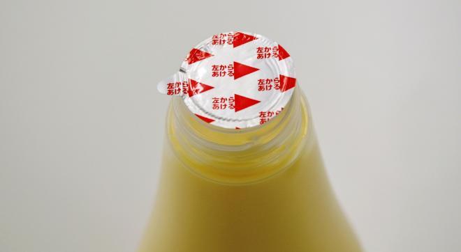 1988年には、ボトルの口部にアルミシールを採用