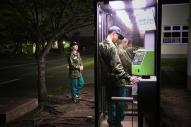 電話の順番を待つ和久巧凌さん(16)。レスリングで東京五輪を目指す。自衛官になって、病気の母に早く自立した姿を見せたい、とこの学校を選んだ=2015年4月、神奈川県横須賀市