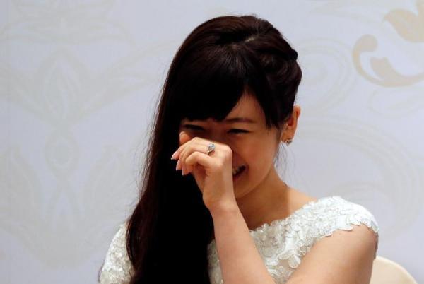 【2016年9月22日】台湾で結婚を発表した福原愛選手と江宏傑選手=ロイター