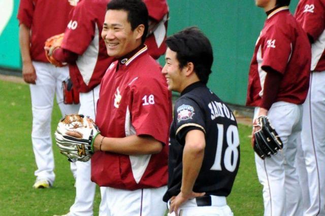 談笑する田中と斎藤