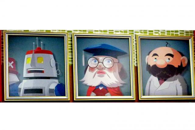 スタジオセットには歴代の「天才博士」の肖像がかけられた=名古屋市中区