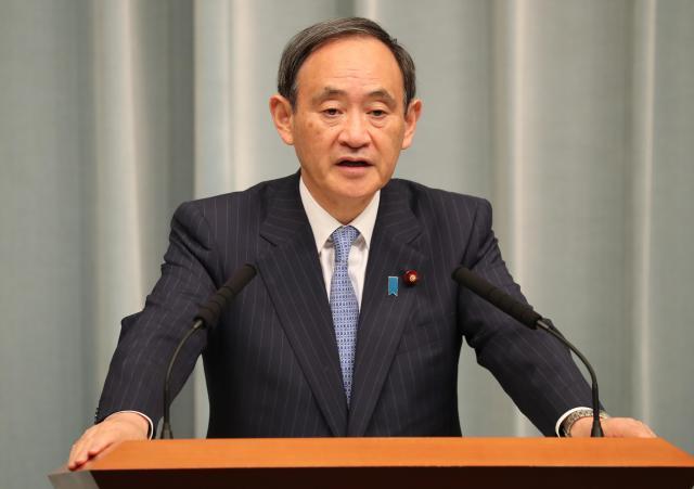 記者会見で「基本的には(武器等防護の実施は)公表しない」と述べた菅義偉官房長官