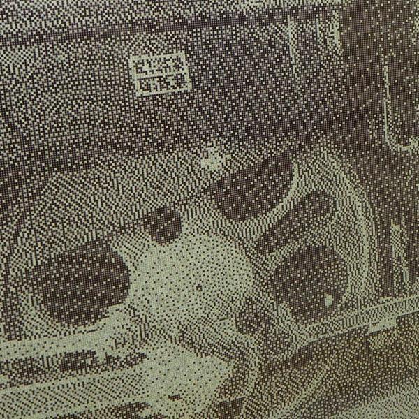 切符のパンチくずで描かれた機関車