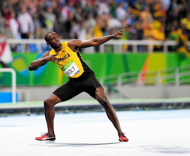 リオ五輪男子200メートルで優勝し、ポーズを決めるウサイン・ボルト=2016年8月18日、諫山卓弥撮影