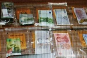 金正男氏が殺害された時に持っていた遺留品の各国紙幣。米ドル(左上)やユーロ(中央上)、スイス・フラン(左下)、人民元(右下)などがある=関係者提供