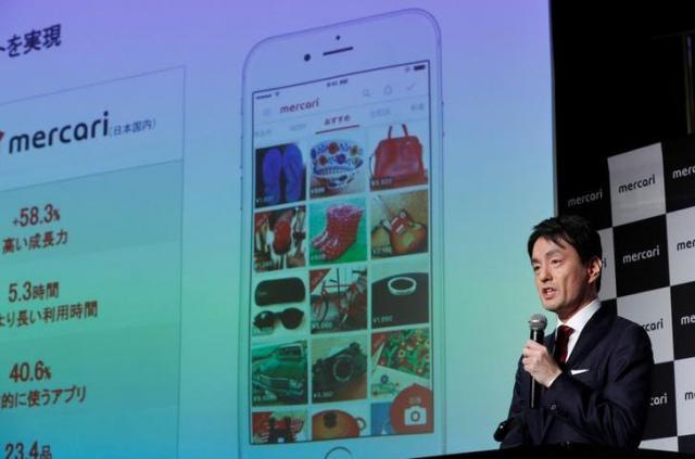 メルカリの事業を説明する山田進太郎CEO=ロイター