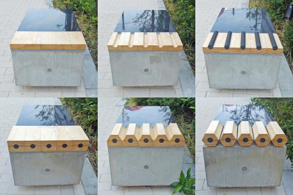 三菱鉛筆の本社新社屋に設置された「6つのベンチ」。並んでいる順番に見ていくと鉛筆の製造工程がわかる仕掛けになっている