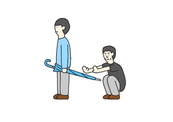 話題のイラストの1枚目。危ない傘の持ち方をしている男性に対して、ユリ・ゲラーさんらしき男性が何かを念じると……