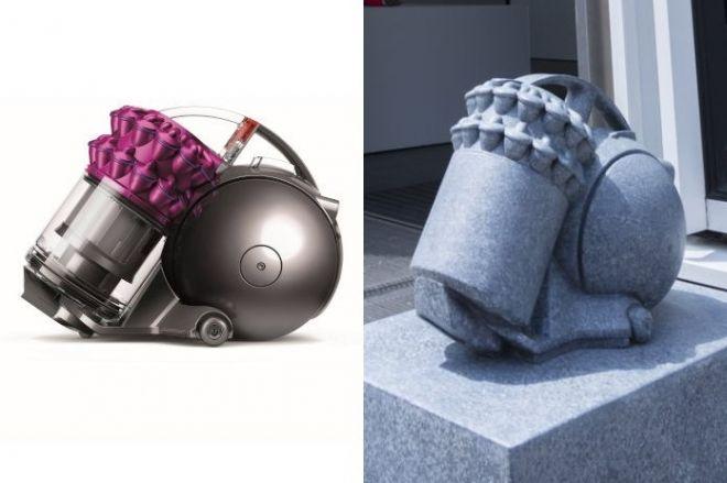 モチーフになったキャニスター型サイクロン式掃除機「DC63」(左)と石像(現在は設置されていません)