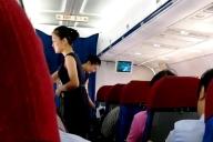 平壌行きの北朝鮮国営高麗航空内で飲み物を提供する客室乗務員ら