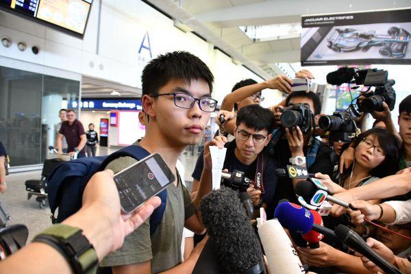 タイに入国できず、香港に強制送還された雨傘運動の学生リーダー、黄之鋒さん=2016年10月5日、香港、益満雄一郎撮影