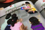 堀祐美子さんのダウン症の長女は、学校に通っていた頃、図書館などで地域の子どもたちに絵本の読み聞かせをやっていた。写真は一冊の本に収められている=東京都葛飾区